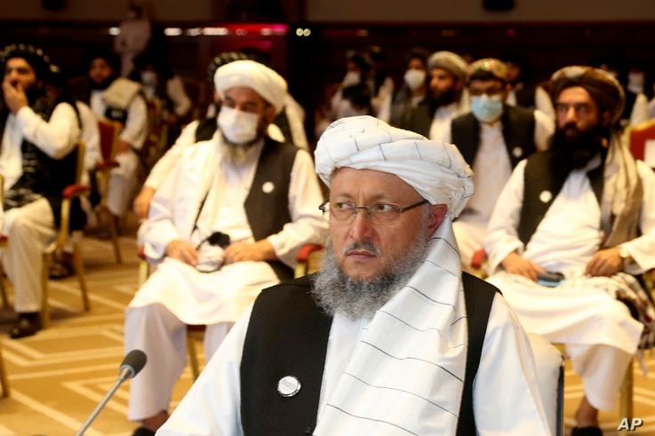 Deputy Head of Political Office of the Taliban Abdul Salam Hanafi, attends the opening session of the peace talks between the Afghan government and the Taliban in Doha, Qatar, Sept. 12, 2020.