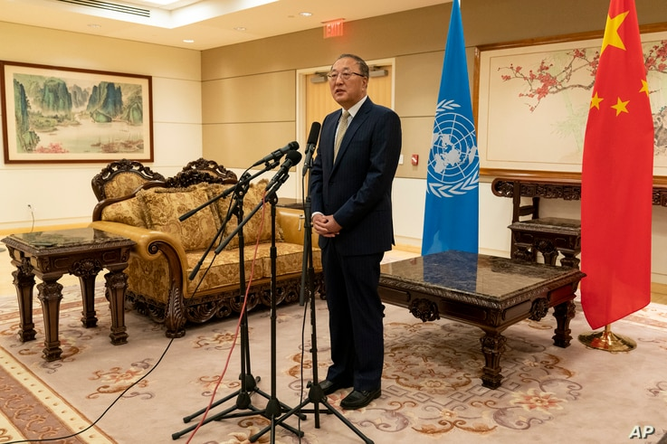 Chinese Ambassador to the United Nations Zhang Jun speaks to reporters, Tuesday, Sept. 22, 2020, at the Chinese Mission to the United Nations in New York.