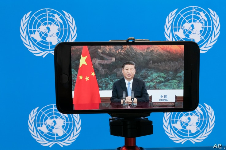 Chinese President Xi Jinping is seen on a phone screen remotely addressing the 75th session of the United Nations General Assembly, Sept. 22, 2020, at U.N. headquarters.