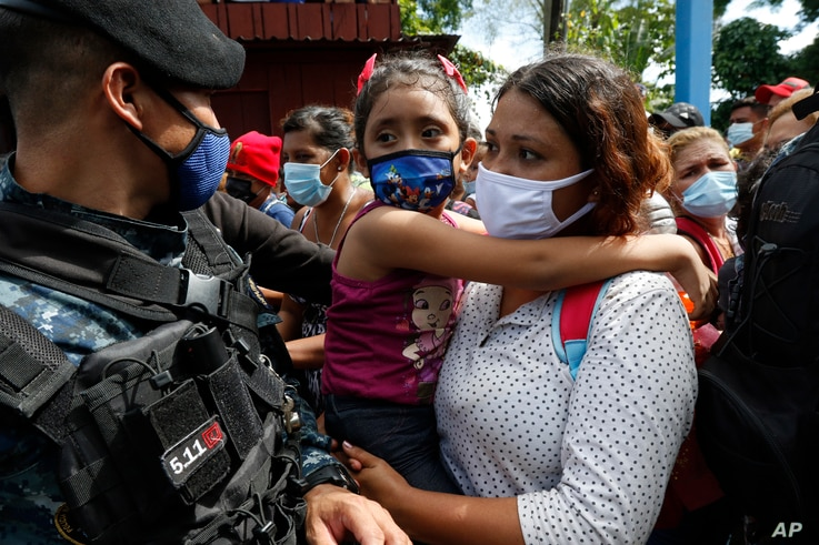 Migrants attempt to cross the border from Corinto, Honduras, into Corinto, Guatemala, Thursday, Oct. 1, 2020. Hundreds of…