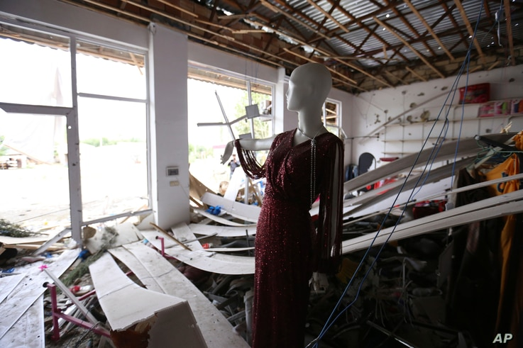 A mannequin inside a shop damaged by shelling during fighting over the breakaway region of Nagorno-Karabakh in Agdam, Azerbaijan, Thursday, Oct. 1, 2020.