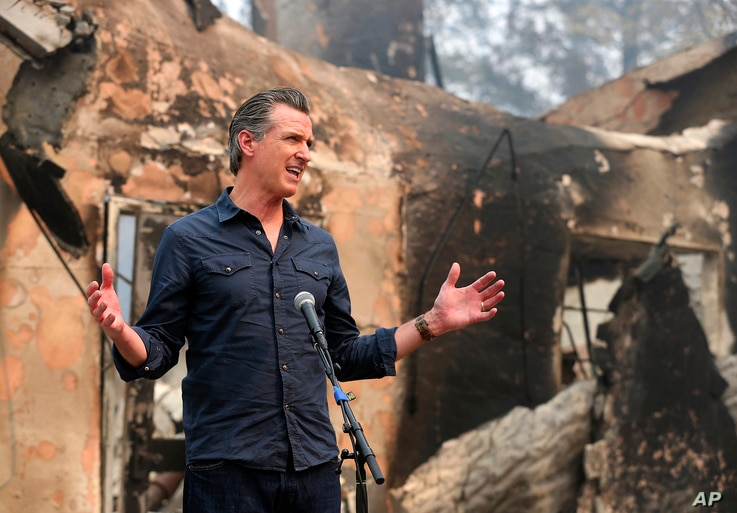California Governor Gavin Newsom speaks at a press conference while touring areas damaged by the Glass Fire at Foothills…