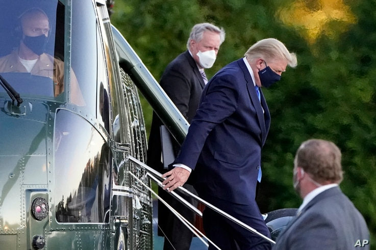 President Donald Trump arrives at Walter Reed National Military Medical Center, in Bethesda, Md., Friday, Oct. 2, 2020, on…