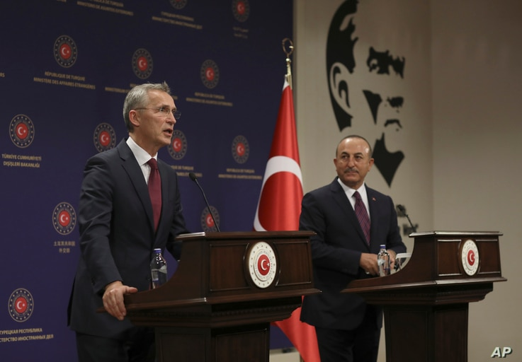 NATO Secretary-General Jens Stoltenberg, left, and Turkey's Foreign Minister Mevlut Cavusoglu speak to the media after their talks in Ankara, Turkey, Oct. 5, 2020.