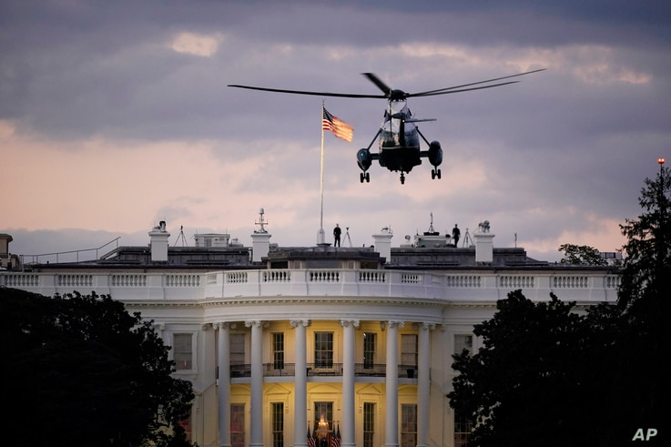 President Donald Trump arrives back at the White House aboard Marine One, Monday evening, Oct. 5, 2020 in Washington, after…
