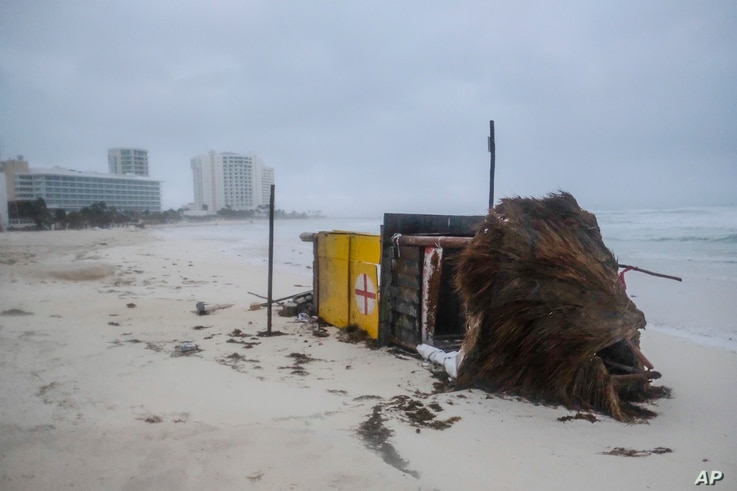 A lifeguard tower lays on its side after it was toppled over by Hurricane Delta in Cancun, Mexico, Oct. 7, 2020.