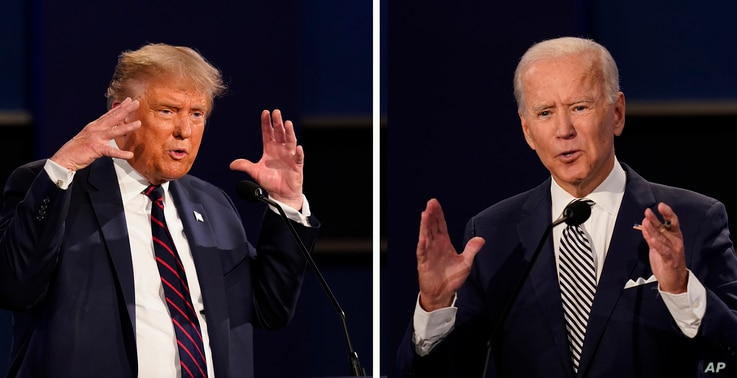 FILE - This combination of Sept. 29, 2020, file photos show President Donald Trump, left, and former Vice President Joe Biden during the first presidential debate at Case Western University and Cleveland Clinic, in Cleveland, Ohio.