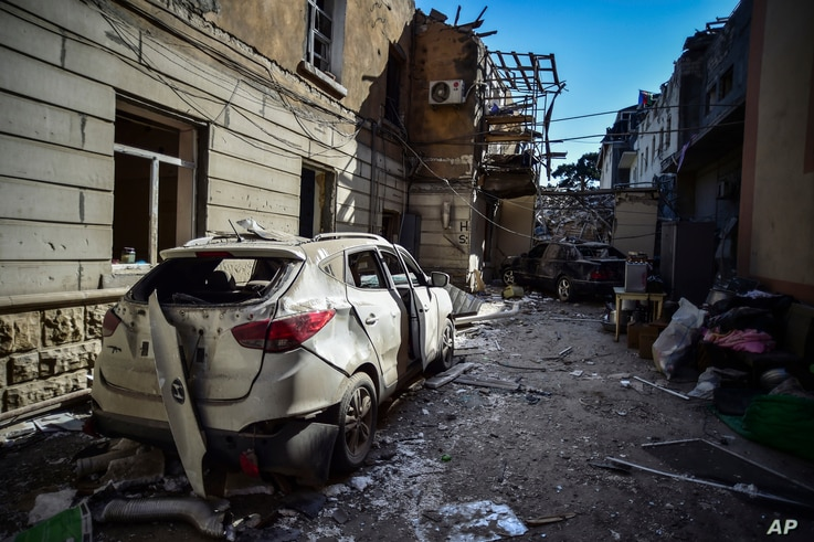 The scene of damage a day after shelling by Armenian's artillery during fighting over the separatist region of Nagorno-Karabakh, in Ganja, Azerbaijan, Oct. 12, 2020.