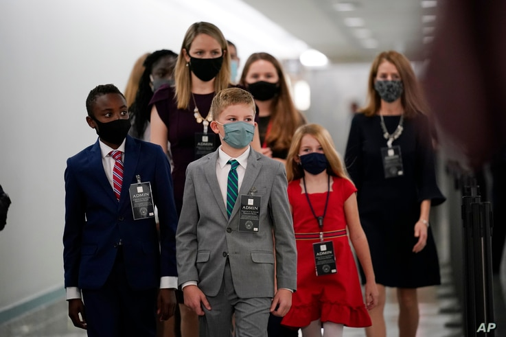 The children of Supreme Court nominee Amy Coney Barrett arrive on Capitol Hill before she will begin her confirmation hearing…