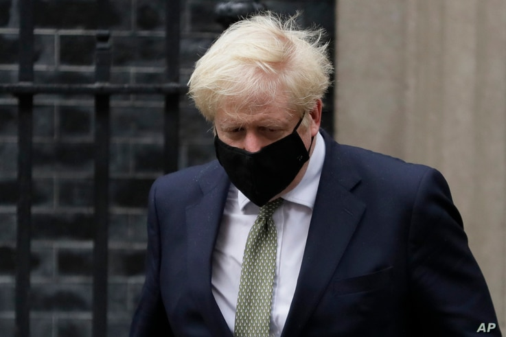 Britain's Prime Minister Boris Johnson leaves Downing Street to attend parliament in London, Monday, Oct. 12, 2020. British…