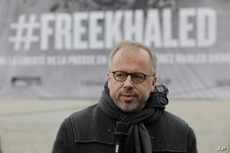 Christophe Deloire, head of RSF (Reporters without borders) is pictured in front of a giant portrait of Algerian journalist Khaled Drareni Thursday Oct.15, 2020 in Paris.