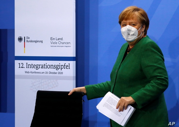 German Chancellor Angela Merkel arrives for the National Integration Summit at the Chancellery in Berlin, Germany, Oct. 19, 2020.