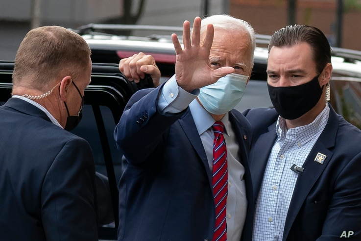 Democratic presidential candidate former Vice President Joe Biden waves as he arrives at The Queen theatre in Wilmington, Del.,…