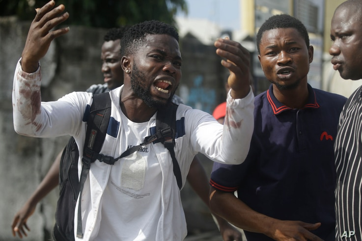Alister, a protester who says his brother Emeka died from a stray bullet from the Army, reacts while speaking to Associated…