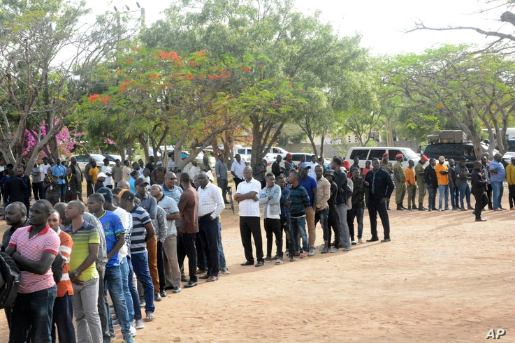 Residents lineup to cast their vote, Oct. 28, 2020, in Dodoma, Tanzania, for a presidential election that the opposition warns is already deeply compromised by manipulation and deadly violence.