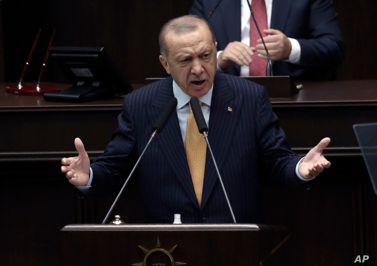 Turkey's President Recep Tayyip Erdogan addresses his ruling party lawmakers at the parliament, in Ankara, Turkey, Wednesday,…