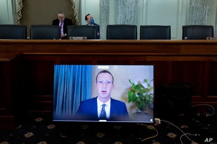 Facebook CEO Mark Zuckerberg appears on a screen as he speaks remotely during a hearing before the Senate Commerce Committee on Capitol Hill, Oct. 28, 2020, in Washington.