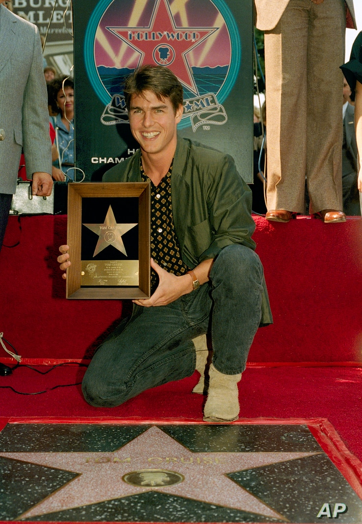 Actor Tom Cruise poses with his new star on the Hollywood Walk of Fame on Hollywood Boulevard, Oct. 16, 1986.  Cruise starred…