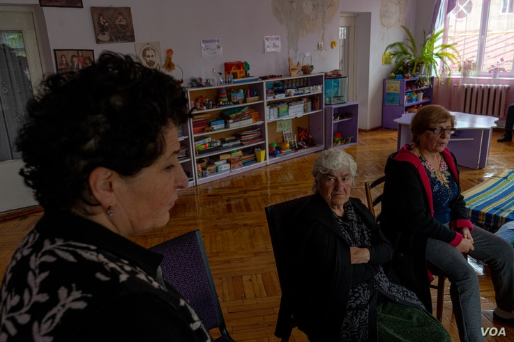 Angela Hovakimyan, center and her daughters, Evelina Sangsyan, left, and Elmira Avagyan say they fled their homes, but they will return as soon as possible on Oct. 8, 2020 in Goris, Armenia. (Yan Boechat/VOA)