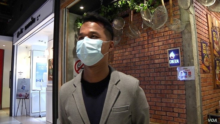 Alex Chong says a recent spike in confirmed cases of COVID-19 in Malaysia has meant a dramatic drop in business at his company's nine restaurants. (David Grunebaum/VOA)