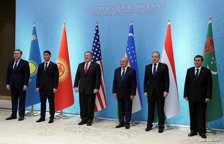 U.S. Secretary of State Mike Pompeo poses with Kazakh Foreign Minister Mukhtar Tleuberdi, Kyrgyzstan's Foreign Minister Chingiz…