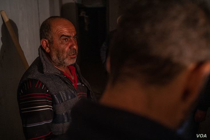 A man identifying himself as Lord Milord takes shelter underground after bombing in Nagorno Karabakh, Oct. 9, 2020. (Yan Boechat/VOA)