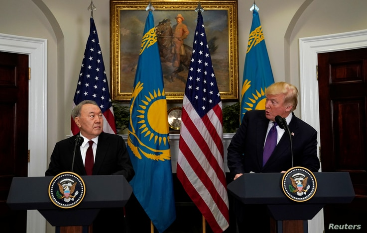 U.S. President Donald Trump and Kazakhstan President Nursultan Nazarbayev speak in the Roosevelt Room of the White House in…