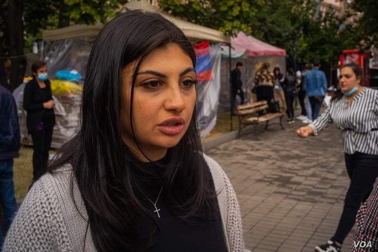 Suzie Azizbekyan, 23, says, for her, the fight for Nagorno-Karabakh is a fight for her country's existence amid growing outrage on both sides in Yerevan, Armenia on Oct. 6, 2020. (VOA/Yan Boechat)