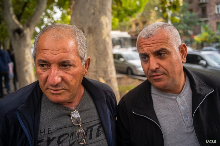 Grigor, left, and Arsan are bus driver who worry the current conflict is growing more dangerous than ever in about 30 years of war for Nagorno-Karabakh, in Yerevan, Armenia on Oct. 6, 2020. (Yan Boechat/VOA)