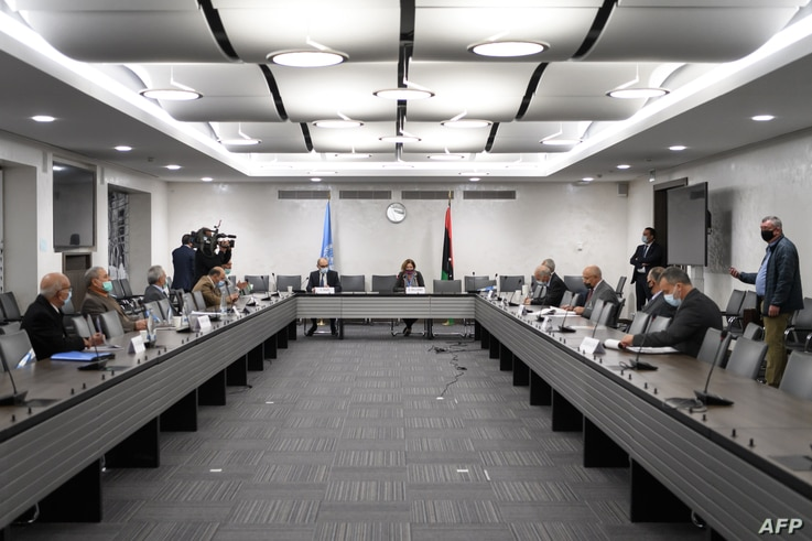 Representatives of rival factions in the Libya conflict are seen during talks at United Nations offices in Geneva, Switzerland, Oct. 20, 2020.