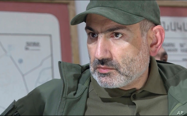 In this grabtaken from a video released by the Armenian Prime Minister Press Service, Oct. 6, 2020, Prime Minister Nikol Pashinyan attends a meeting with army commanders in the self-proclaimed Republic of Nagorno-Karabakh, Azerbaijan.