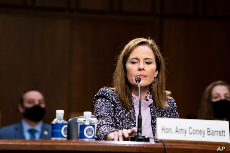Supreme Court nominee Amy Coney Barrett tests her microphone during a confirmation hearing before the Senate Judiciary Committee, Capitol Hill in Washington, Oct. 14, 2020.