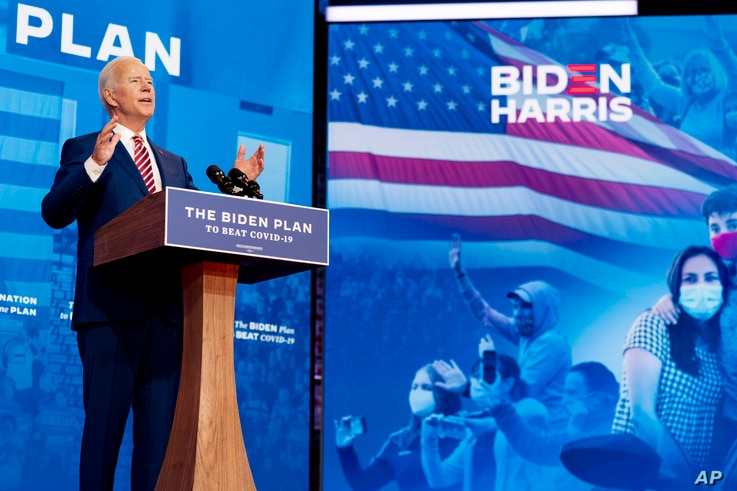FILE - Democratic presidential candidate former Vice President Joe Biden speaks at The Queen Theater in Wilmington, Delaware, Oct. 23, 2020.