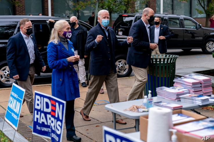 Democratic presidential candidate former Vice President Joe Biden arrives to speak with supporters outside a voter service center, in Chester, Pennsylvania, Oct. 26, 2020.