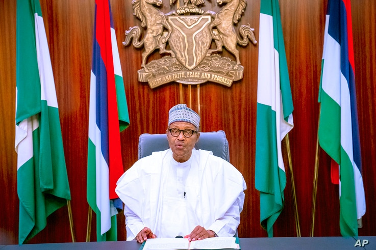In this photo released by the Nigeria State House, Nigeria's President Muhammadu Buhari addresses the nation in a live televised broadcast, Oct. 22, 2020.