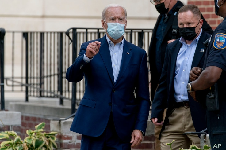 Democratic presidential candidate former Vice President Joe Biden speaks to member of the media as he leaves St. Joseph Catholic Church, Oct. 3, 2020, in Wilmington, Delaware.