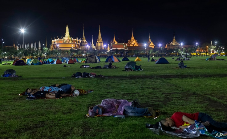 FILE - Pro-democracy activists sleep in the historic field of Sanam Luang they occupied for an overnight protest rally in Bangkok, Thailand, Sept. 20, 2020.