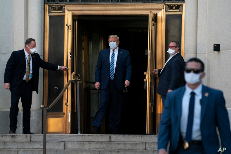 President Donald Trump walks out of Walter Reed National Military Medical Center after receiving treatment as a COVID-19 patient, in Bethesda, Maryland, Oct. 5, 2020.