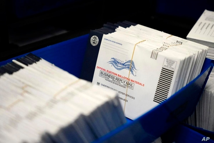 Mail-in ballots for the 2020 election after seen after being sorted at the Chester County Voter Services Office in West Chester, PA. (Matt Slocum/AP)