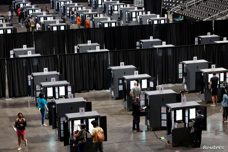 People cast their ballots during early voting for the upcoming presidential elections inside of The Atlanta Hawks' State Farm Arena in Atlanta, Georgia, USA..
