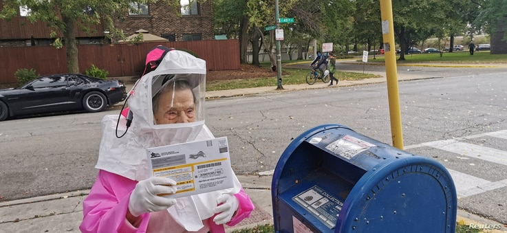 Beatrice Lumpkin, 102-year-old former teacher, casts her vote-by-mail ballot in Chicago, Oct. 1, 2020, in this picture obtained from social media.