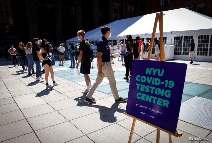 Students wait in line at a testing site for the COVID-19 set up for returning students, faculty and staff on the main campus of New York University (NYU) in Manhattan in New York City, Aug. 18, 2020.