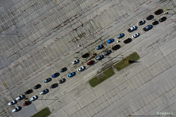 Aerial view of people waiting in their vehicles for COVID-19 tests at a drive-thru testing site in the parking lot of Miller Park as the coronavirus disease outbreak continues in Milwaukee, Wisconsin, Oct. 21, 2020.