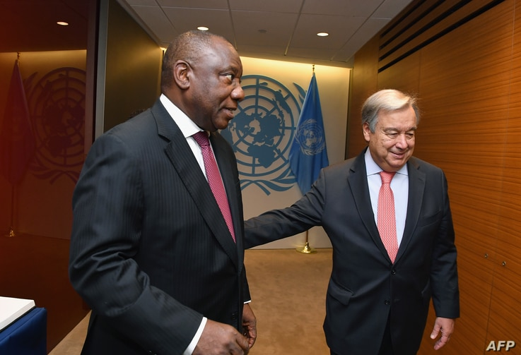 United Nations Secretary-General Antonio Guterres (R) greets South Africa's President Matamela Cyril Ramaphosa at the United…