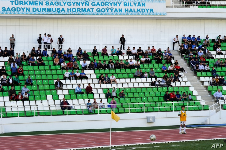 Football supporters attend the Turkmenistan national football championship match between Altyn Asyr and Kopetdag on April 19,…