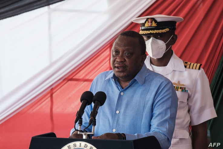 Kenya's President Uhuru Kenyatta speaks during the official opening of renovated Nyayo National Stadium with 45,000 seat...