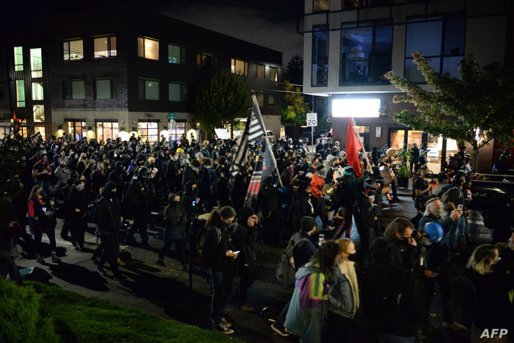 Black Lives Matter protesters march through the streets of Southeast Portland, Oregon, on November 3, 2020. - President Donald…