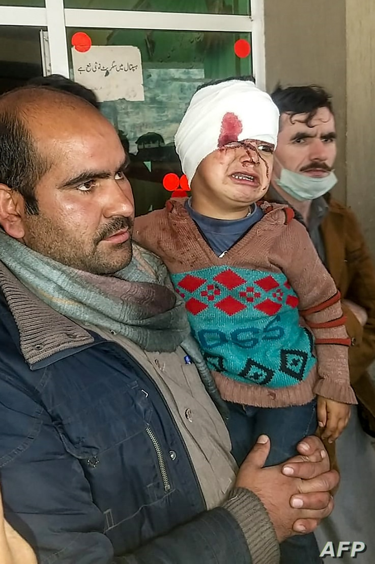 EDITORS NOTE: Graphic content / A Pakistani Kashmiri carries an injured child at a hospital following cross border shelling…