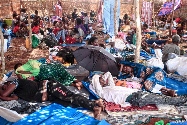 Ethiopian refugees who fled fighting in Tigray province lay in a hut at the Um Rakuba camp in Sudan's eastern Gedaref province,…