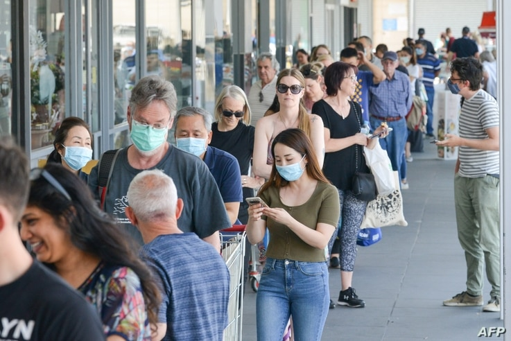 People queue at a supermarket after the South Australian state government announced a six-day lockdown because of a Covid-19…